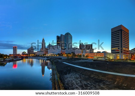 Scioto River and Columbus Ohio skyline at John W. Galbreath Bicentennial Park at dawn - stock photo
