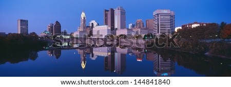 Scioto River and Columbus Ohio skyline, the capital city, at dusk with lights on - stock photo