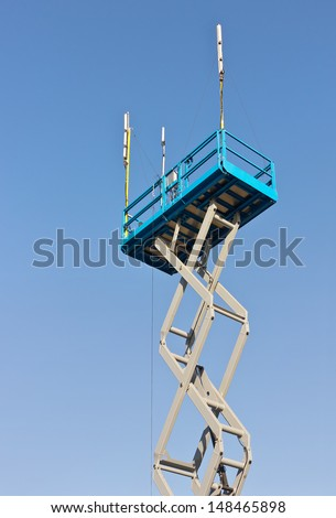 Scissor lift is used at its maximum height range.  - stock photo