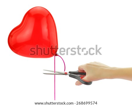 "Scissors about to ""set free"" heart balloon isolated on white - stock photo"