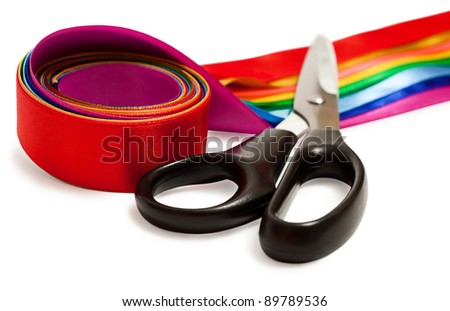 Scissors and a satin ribbons isolated on the white background - stock photo