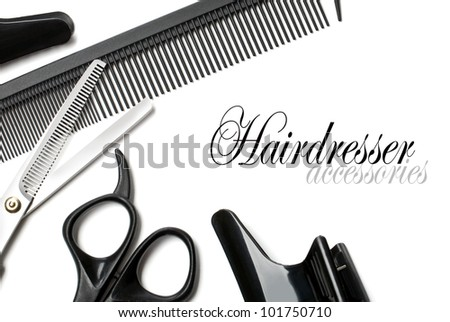 scissors and comb on a white background - stock photo