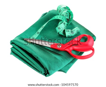 Scissors and measuring tape on fabric isolated on white
