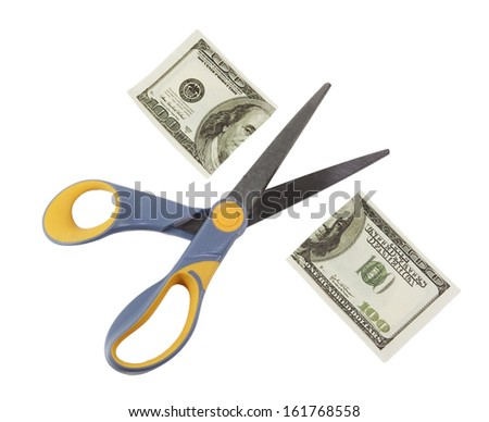 scissors cut a hundred dollar bill in half isolated on white background - stock photo