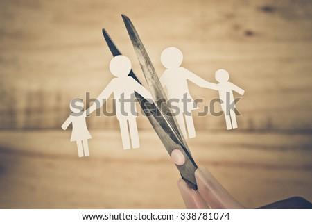 Scissors cutting paper cut of family / Broken family concept / divorce - stock photo