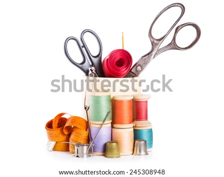 scissors, various threads  and sewing tools on white background - stock photo
