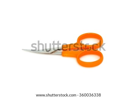 Scissors with orange handles on a white background