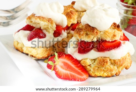 Scones, strawberries and cream - stock photo