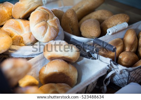 Scones, wheat buns and bread in bakery display