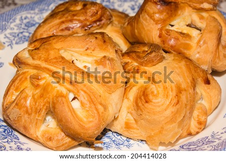 scones with cream on a plate on the table - stock photo