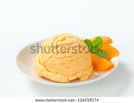 Scoop of apricot ice cream  - stock photo