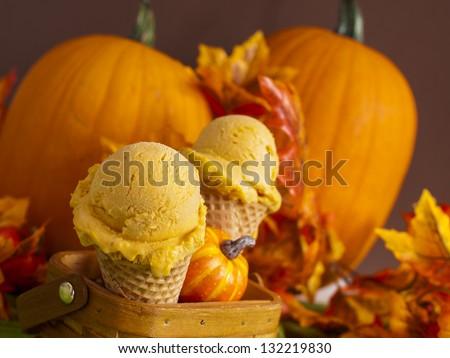 Scoop of gourmet pumpkin gelato in waffle cones. - stock photo
