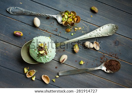 Scoop of homemade pistachio ice cream with chopped pistachios and ...