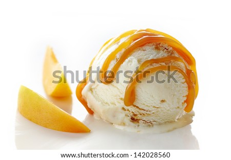 scoop of ice cream and apricot on white background - stock photo