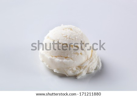 Scoop of lemon ice cream with fresh berries