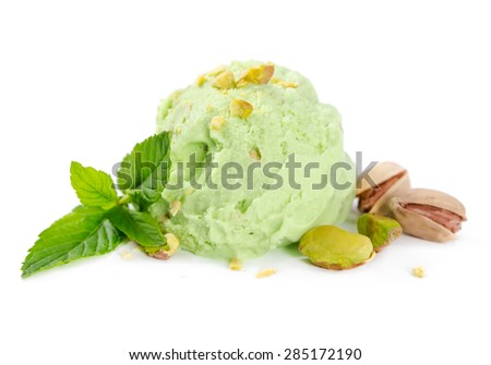 Scoop of pistachio ice cream with nuts and mint isolated on white background - stock photo