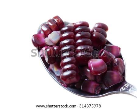 Scoop purple corn on white background. - stock photo