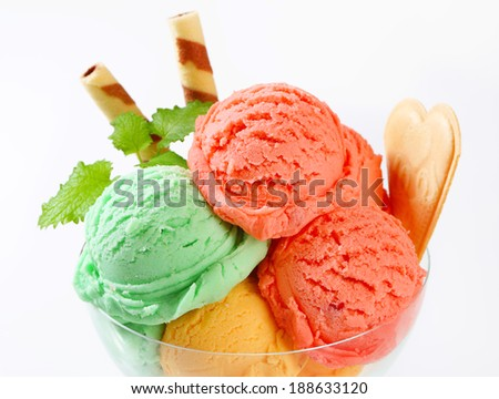 Scoops of fruit sherbets decorated with wafers - stock photo