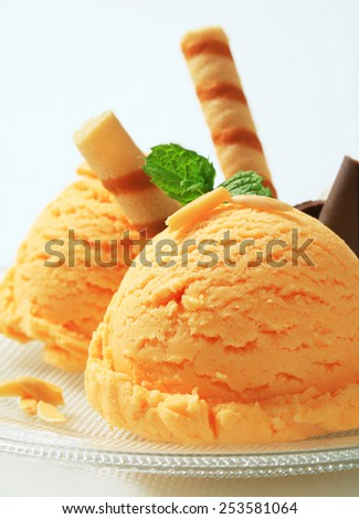 Scoops of ice cream garnished with wafer rolls - stock photo