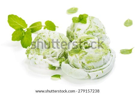 Scoops of mint or kiwi ice cream decorated with leaves of mint isolated on white background - stock photo