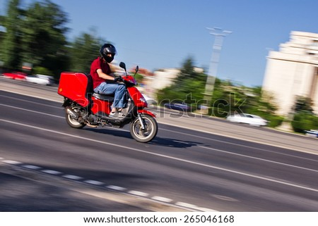 Scooter delivery man - stock photo
