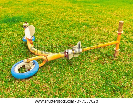 Scooter isolated in the grass - stock photo