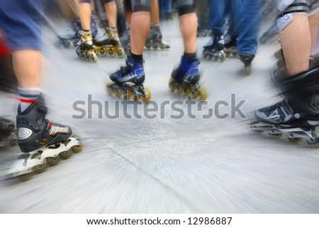 scooters. inline  skating in downtown - stock photo