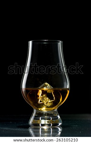Scotch Glencairn Glasses with Beautiful Amber Scotch Whisky - stock photo