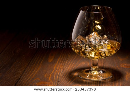 Scotch Whiskey in a Crystal Glass over Back - stock photo