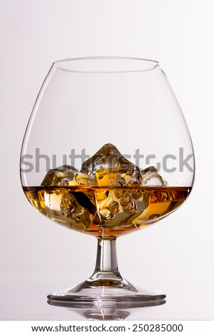 Scotch Whiskey in a Crystal Glass over Light Grey - stock photo