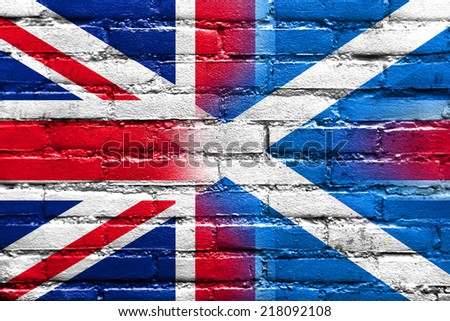 Scotland and United Kingdom Flag painted on brick wall - stock photo