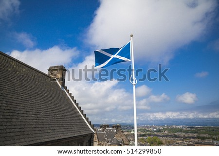 Scotland flag flying in the blue sky, Scotland