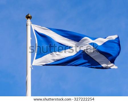 Scotland flag with blue sky - stock photo