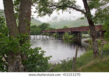 Scotland, Loch Awe and railway bridge - stock photo
