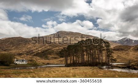 Scotland Loch eilt cottage - stock photo