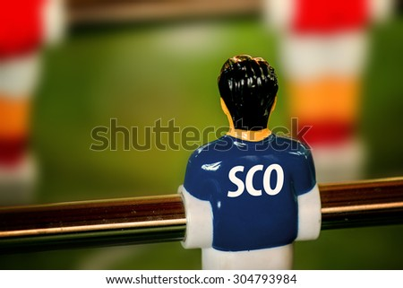 Scotland National Jersey on Vintage Foosball, Table Soccer or Football Kicker Game, Selective Focus, Retro Tone Effect - stock photo