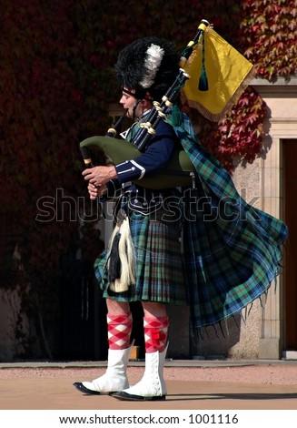 Scottish bagpiper - stock photo