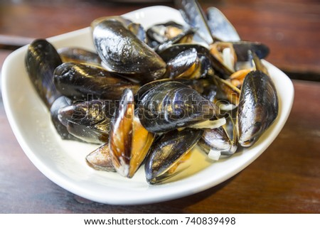 Scottish Mussels  with white wine, garlic and onion, finished with cream served with bread