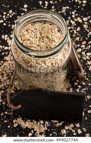 scottish toasted oats in a storage glass on slate