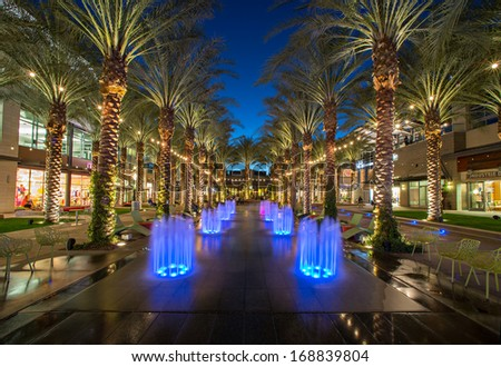 SCOTTSDALE, ARIZONA - MARCH 12: Splash pad lit up at night at the Scottsdale Quarter shopping center in Scottsdale, Arizona on March 12, 2013.  North Scottsdale is a desirable tourist destination. - stock photo