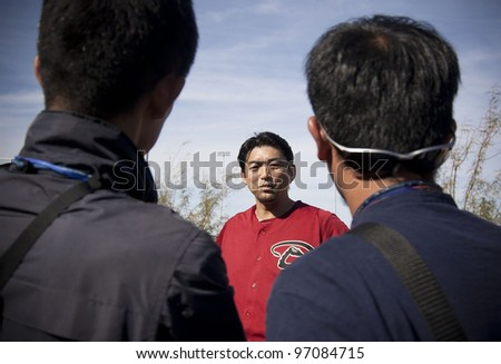 SCOTTSDALE, ARIZONA, USA – FEBRUARY 20: Takashi Saito of the Arizona Diamondbacks speaks with Japanese media on the first day of Spring Training in Phoenix Arizona on February 20 2012.
