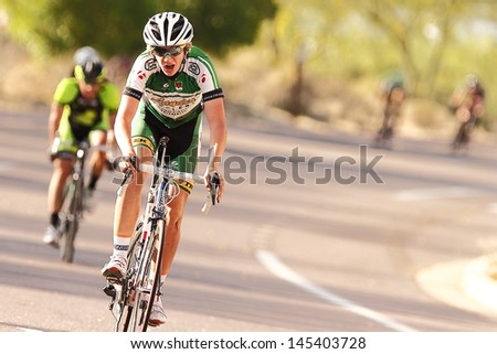 SCOTTSDALE, AZ - MAY 19: Brandon McNulty competes in the Criterium at DC Ranch, a high-speed circuit race on a 1-kilometer closed course on May 19, 2013 in Scottsdale, AZ.  - stock photo