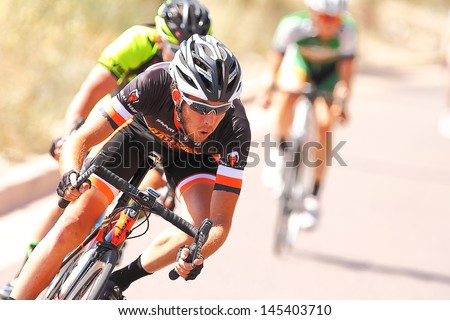 SCOTTSDALE, AZ - MAY 19: Daniel Eaton competes in the Criterium at DC Ranch, a high-speed circuit race on a 1-kilometer closed course on May 19, 2013 in Scottsdale, AZ.  - stock photo