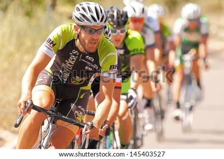 SCOTTSDALE, AZ - MAY 19: David Straus competes in the Criterium at DC Ranch, a high-speed circuit race on a 1-kilometer closed course on May 19, 2013 in Scottsdale, AZ.