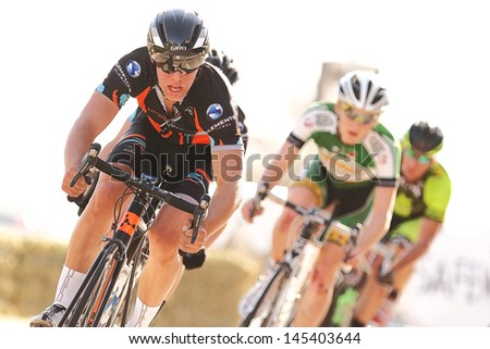 SCOTTSDALE, AZ - MAY 19: Domenic Suozzi leads the pack during the Criterium at DC Ranch, a high-speed circuit race on a 1-kilometer closed course on May 19, 2013 in Scottsdale, AZ.  - stock photo