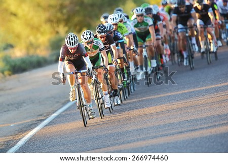 SCOTTSDALE, AZ - OCTOBER 13: Cyclists compete in the 10th annual Tour de Scottsdale, a 70-mile charity bicycle race benefiting the McDowell Sonoran Conservancy in Scottsdale, AZ on October 13, 2013. - stock photo