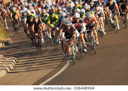 SCOTTSDALE, AZ - OCTOBER 13: Cyclists compete in the 10th annual Tour de Scottsdale, a 70-mile charity bicycle race benefiting the McDowell Sonoran Conservancy in Scottsdale, AZ on October 13, 2013.