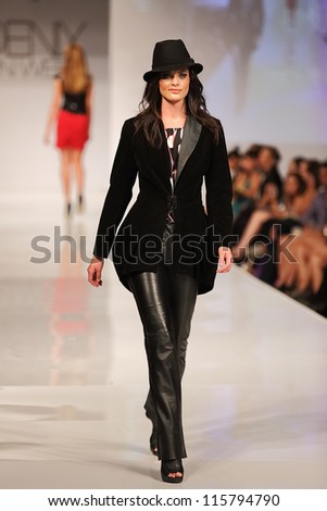 SCOTTSDALE, AZ - OCTOBER 4: Models showcasing designs during a runway fashion show at the Phoenix Fashion Week on October 4, 2012  in Scottsdale, Arizona. - stock photo