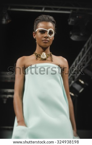 SCOTTSDALE, AZ - OCTOBER 3, Models showcasing designs from the Azmara Asefa collection during a runway show at the Phoenix Fashion Week at Talking Stick Resort on October 3, 2015 in Scottsdale, AZ. - stock photo