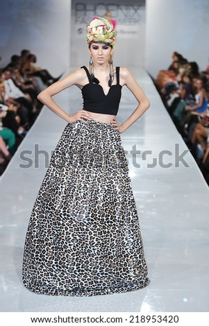 SCOTTSDALE, AZ - OCTOBER 3: Models showcasing designs from the Black Russian Label during a runway show at the Phoenix Fashion Week at Talking Stick Resort on October 3, 2013 in Scottsdale, Arizona.  - stock photo